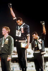 Tommie Smith and John Carlos giving the Black Power Salute at the 1968 Olympics